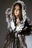 Woman in fur coat Stock Photo