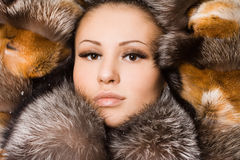 Woman in a fur coat Stock Images
