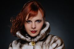 Woman with fur coat Stock Photos