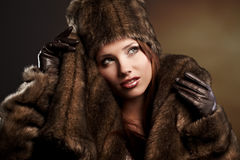 Woman in a fur coat Stock Image