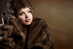 Woman in a fur coat Royalty Free Stock Image