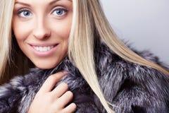 Woman in fur coat. Young girl in fur coat Royalty Free Stock Photos
