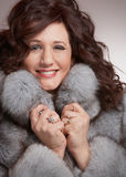 Woman in fur coat Stock Photos