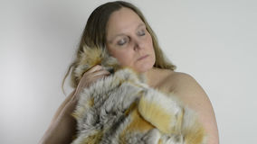 Woman and fur coat Stock Photo