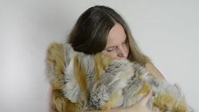 Woman and fur coat Royalty Free Stock Images