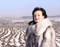 Woman in a fur coat Stock Photography