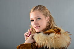 Woman in a fur coat. A beautiful young woman in a fur coat Royalty Free Stock Photography