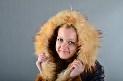 Woman in a fur coat. A beautiful young woman in a fur coat Stock Photo