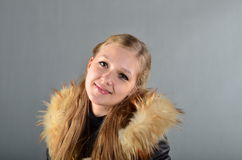 Woman in a fur coat. A beautiful young woman in a fur coat Stock Photos