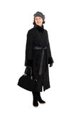 Woman in a fur coat from broadtail. Smiling woman in a fur coat from broadtail (karakul, astrakhan, lambskin Stock Image