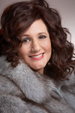 Woman with fur coat closeup Stock Image