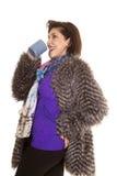 Woman fur coat drink from mug Stock Photos