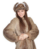 Woman in a fur coat and hat Stock Photos