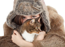 Woman in a fur coat and hat with cat Stock Photography