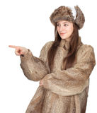 Woman in a fur coat and hat pointing Royalty Free Stock Image