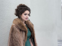 Elegance. Charming Autumn Brunette in Fur Coat in her Thoughts Stock Photo