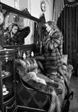 Woman in fur coat in Luxurious interio Royalty Free Stock Photo