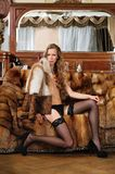 Woman in fur coat in a luxurious interior. Stock Photos
