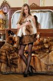Woman in fur coat in a luxurious interior. Stock Images