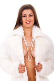 Woman in fur coat with naked breast Stock Photo