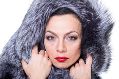 A woman in a fur coat Stock Photography