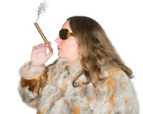 Woman with fur coat and sunglasses smokes a cigar Royalty Free Stock Photography