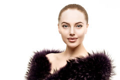 Woman in a fur coat. Young beautiful model in winter outerwear. Royalty Free Stock Image