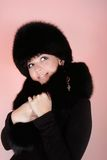 Woman in fur hat Stock Photos