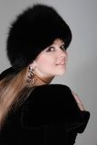 Woman in fur hat Royalty Free Stock Image