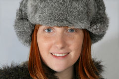 Woman with fur hat Stock Image