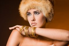 Woman in fur hat Stock Photography