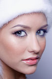 Woman in a fur hat. Beautiful young woman in a fur hat Stock Photo