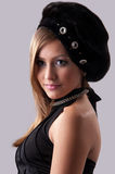 Woman in a fur hat. Beautiful young woman in a fur hat Royalty Free Stock Images