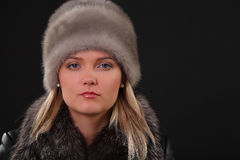 Woman in fur hat. And fur coat Royalty Free Stock Photo