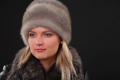 Woman in fur hat. And fur coat Royalty Free Stock Photography