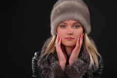 Woman in fur hat. And fur coat Royalty Free Stock Photos