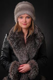 Woman in fur hat. And fur coat Royalty Free Stock Images