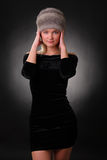 Woman in a fur hat. On a black background Royalty Free Stock Images