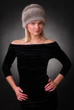 Woman in a fur hat. On a black background Stock Photo