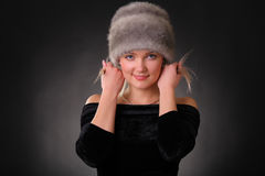 Woman in a fur hat. On a black background Royalty Free Stock Photography