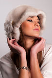 Woman in a fur hat Royalty Free Stock Images