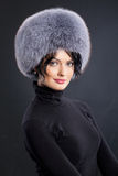 Woman In A Fur Hat Stock Images