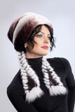 Woman In A Fur Hat. Young attractive woman in a fur hat Royalty Free Stock Photos