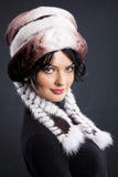 Woman In A Fur Hat. Young attractive woman in a fur hat stock images
