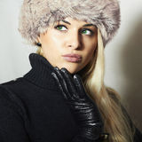 Woman in Fur Hat.Beautiful Blond Girl in Black Leather Gloves Royalty Free Stock Photos