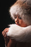 Woman in a fur hat Royalty Free Stock Photos