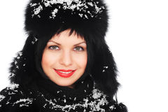 Woman in fur hat covered with snow. Portrait of happy woman in black fur hat covered with snow Royalty Free Stock Images