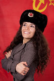 Woman with fur hat in front of former Russian flag Royalty Free Stock Photos