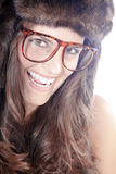 Woman with fur hat and glasses. Beautiful woman with fur hat and glasses Royalty Free Stock Photos