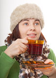 Woman with a fur hat holding glass cup Stock Photos